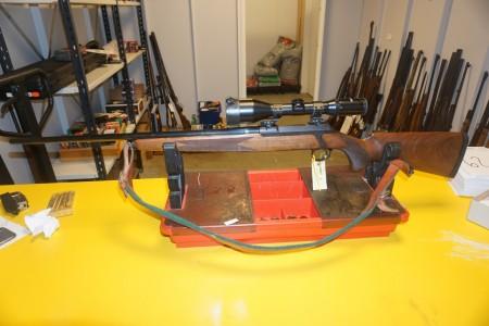 Riffel Sauer 200  Kaliber 6.5X55 våbennummer H18111. Med Tasco Sigtekikkert Euroclass 3-12x52? Løbslængde 75 cm Totallængde 113 cm minus bundstykke