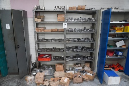 2 compartments steel shelf with content of various clamping tools