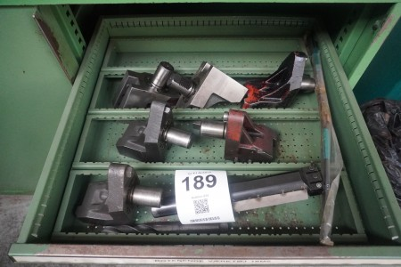 Contents on 3 shelves of various rotating tools, tool holders, plate holders.