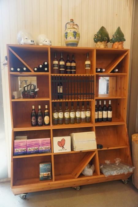 Shop shelf containing wine etc.